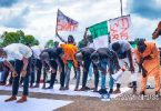 Protesters Hold Jummat Prayers On The Road In Abuja
